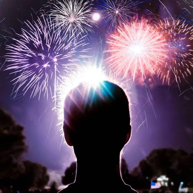a man watching a fireworks