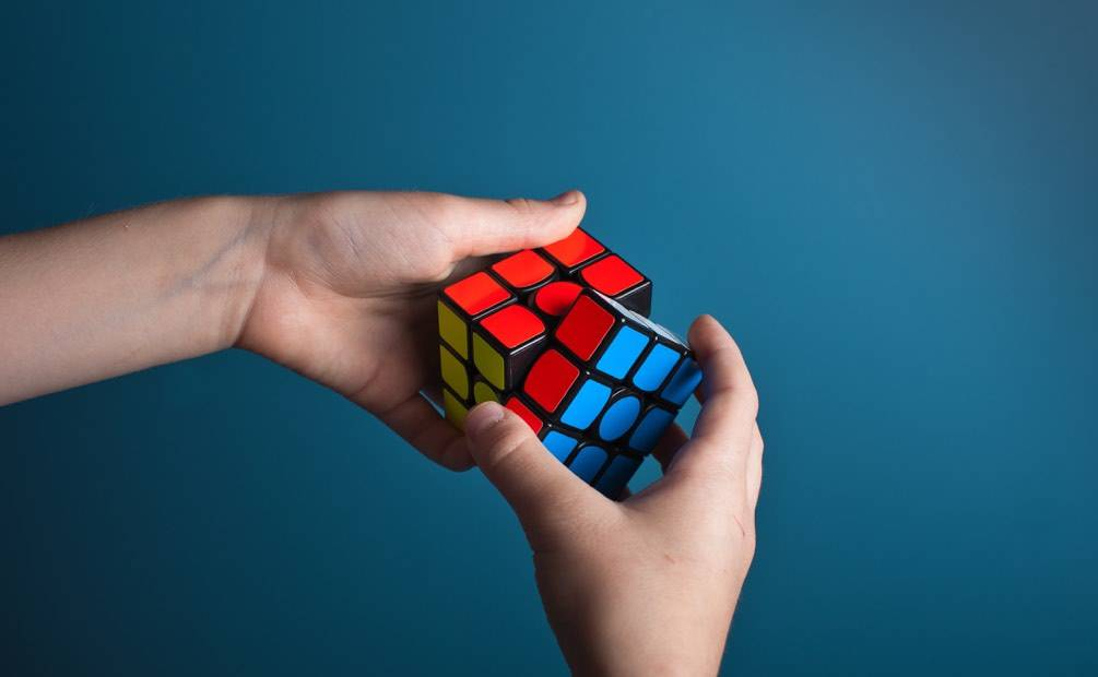a cubic rubix in someone's hands
