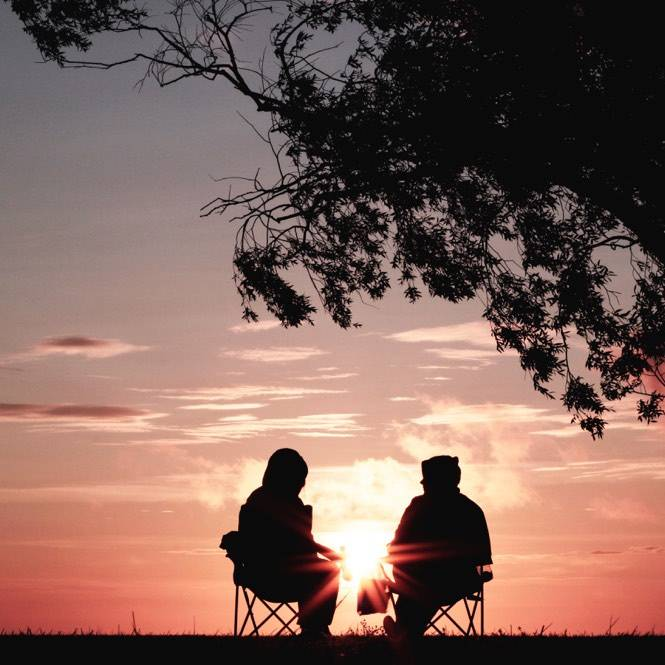 two people talking while watching the horizon