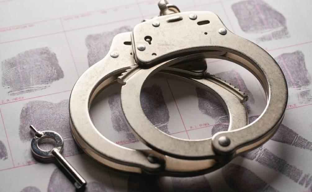 two handcuffs on a calendar