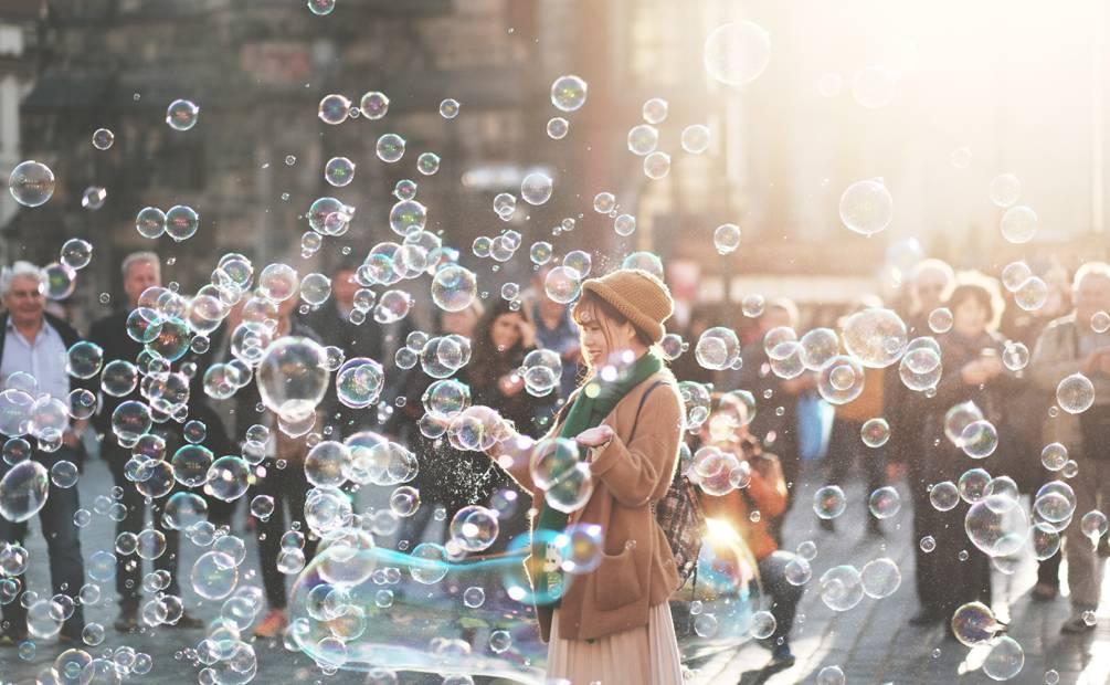 a women makes soap bubbles