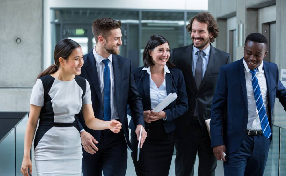 five colleagues smiling